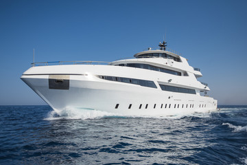 Luxury private motor yacht sailing at sea Wall mural