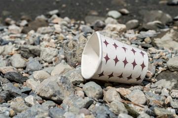 Used paper coffee mug dumped on the costal strip