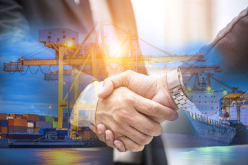 Investment in international trade, Business collaborate hand shake with logistic shipping import and export background.