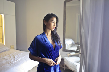 Beautiful woman wearing a blue night gown