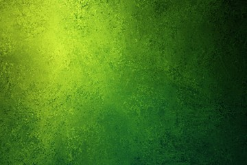 green and yellow background texture with distressed vintage grunge and shiny spotlight corner design