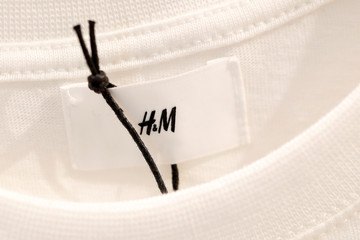 A Hennes & Mauritz AB (H&M) label is pictured on clothes inside their flagship store in Paris