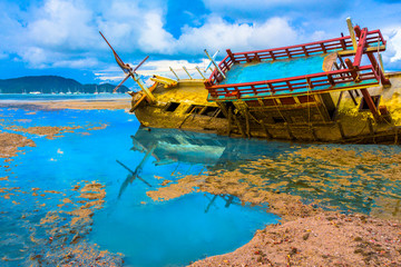 the old ship wreck stuck on the mud near Chalong gulf