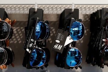 A Hennes & Mauritz AB (H&M) label is pictured on sunglasses inside their flagship store in Paris