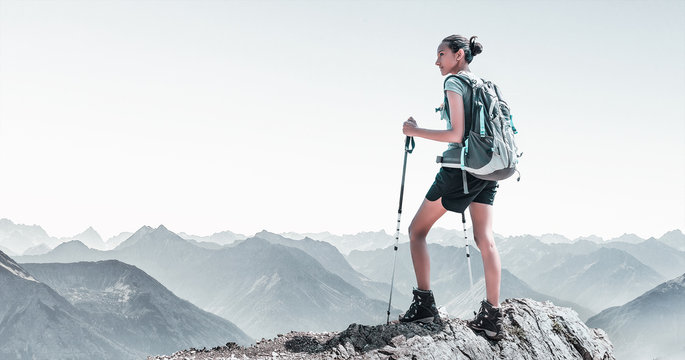 Fit young woman hiking in high altitude mountains