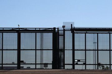 A metal fence lies adjacent to the United States border near the U.S. Customs and Border Protection (CBP) Tornillo, Texas port of entry