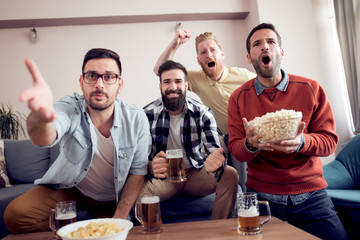 Group of friends watching TV match