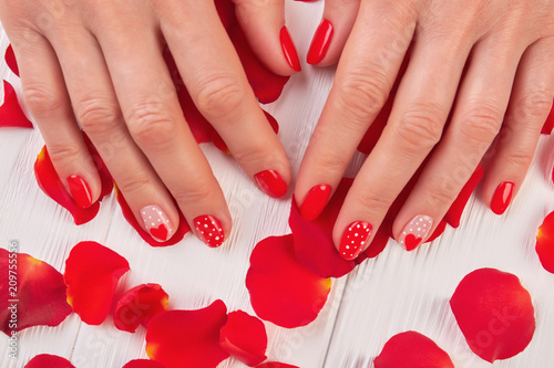 Female Manicured Hands And Rose Petals Woman Finger With Red