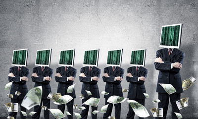 Businessmen with monitors instead of head.