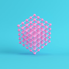 Abstract pink spheres in wire box on bright blue background in pastel colors