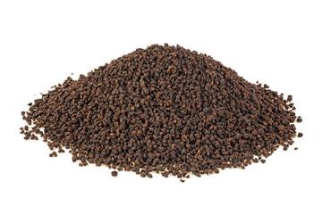 Black tea granules on a white background