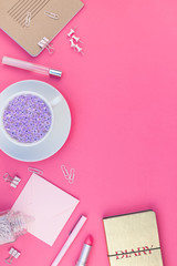 Styled pink feminine workspace flat lay