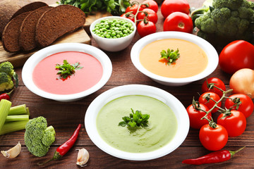 Vegetable cream soup with parsley on wooden table
