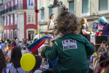 Child with rainbow flag at LGBT Pride Parade