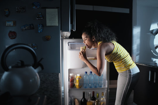 Black Woman Looking into Fridge For Midnight Snack