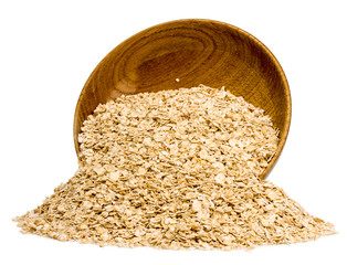 Rolled oats in a wooden bowl isolated on white background