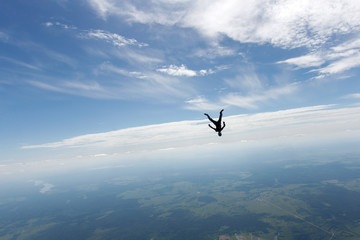 Freefly skydiving. Girl is falling is a headdown position.