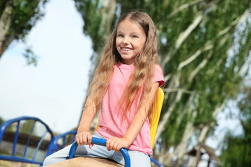 Cute little girl on children's playground