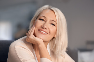 Portrait of smiling mature woman at home Wall mural
