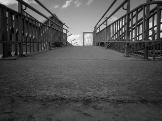 Abstract urban background. Black and white photo. Urban grunge. Railings on pedestrian bridge