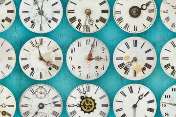 Pattern of different antique weathered clocks