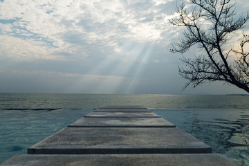 Scenic view from pool to the sea with a beautiful clouds