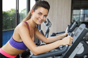 Woman on stationary bike in the gym
