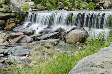 waterfall on a mountain river in the forest 2