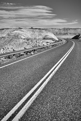 Black and white picture of an empty road, travel concept.