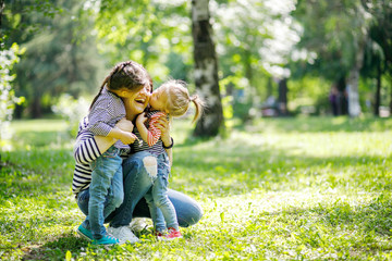 Mother and Daughters are hugging and having fun outdoor in nature