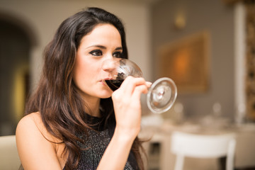 Woman drinking wine. Beautiful young woman drinking wine