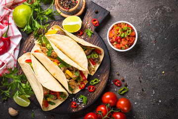 Mexican pork tacos with vegetables and salsa.