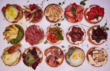 Crostini with different toppings on white background. Delicious appetizers.