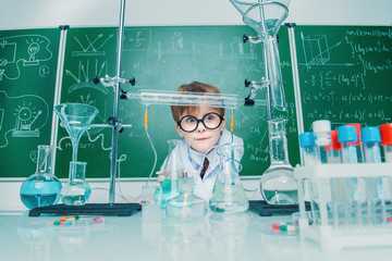 boy in school laboratory