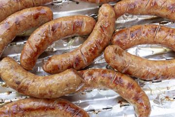 Pork sausages on grill