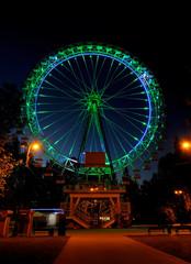 Amusement park at night - big ferris wheel with illumination
