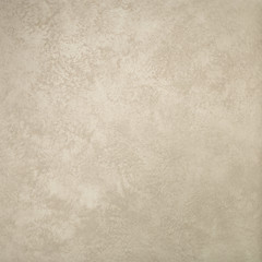 Textured background. Decorative plaster walls, external decoration of facade. Texture of beige