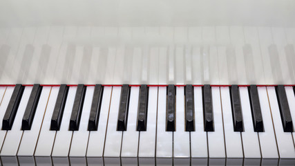 Close Up view of a grand piano white keyboard