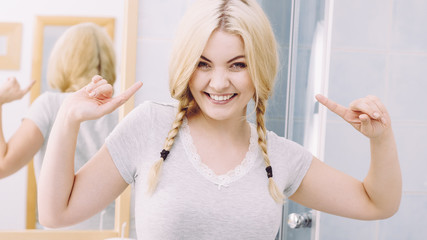 Happy woman having braided blonde hair