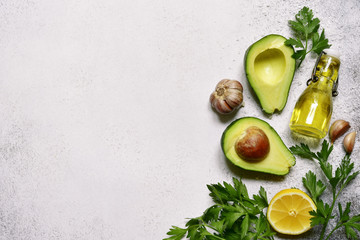 Food background with ingredients for making mexican avocado dip guacamole.Top view with copy space.
