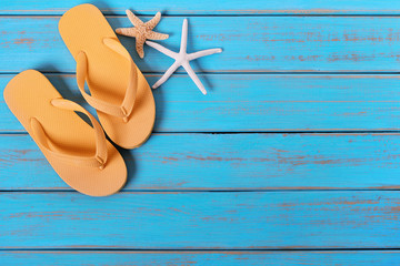 Flip flops starfish old distressed bright blue beach wood