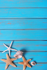 Summer beach seashore background starfish blue old wood vertical