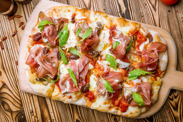 pizza with Parma ham on the Rome Dough