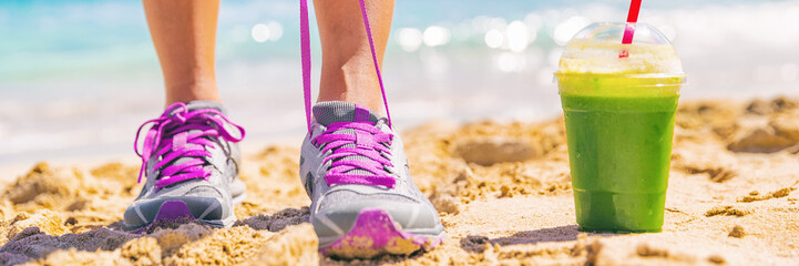 Green smoothie runner fitness woman banner. Panorama crop of person tying running shoes at beach workout. Healthy lifestyle detox weight loss girl lacing trainers.