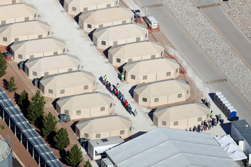 """Immigrant children, many of whom have been separated from their parents under a new """"zero tolerance"""" policy by the Trump administration, are being housed in tents next two the Mexican border in Tornillo, Texas"""