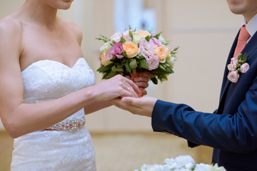 Beautiful wedding colorful bouquet and dress for bride