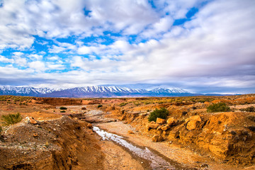 Amazing nature view of stone desert with mountains peaks and beautiful clouds. Location: Morocco, Africa. Artistic picture. Beauty world. The feeling of complete freedom