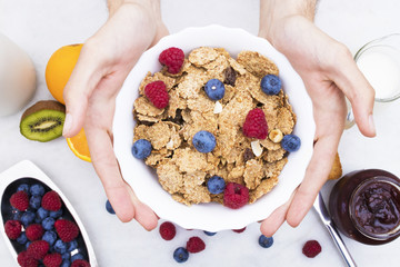 hand-cup cereal with fruit, balanced breakfast