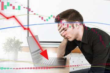 Stressful bearish market for investors.  Red line with price drop and handsome man in home office.