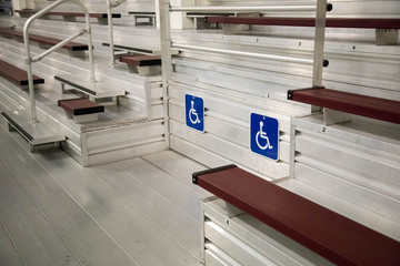 Handicapped seating among metal bleachers at an  arena